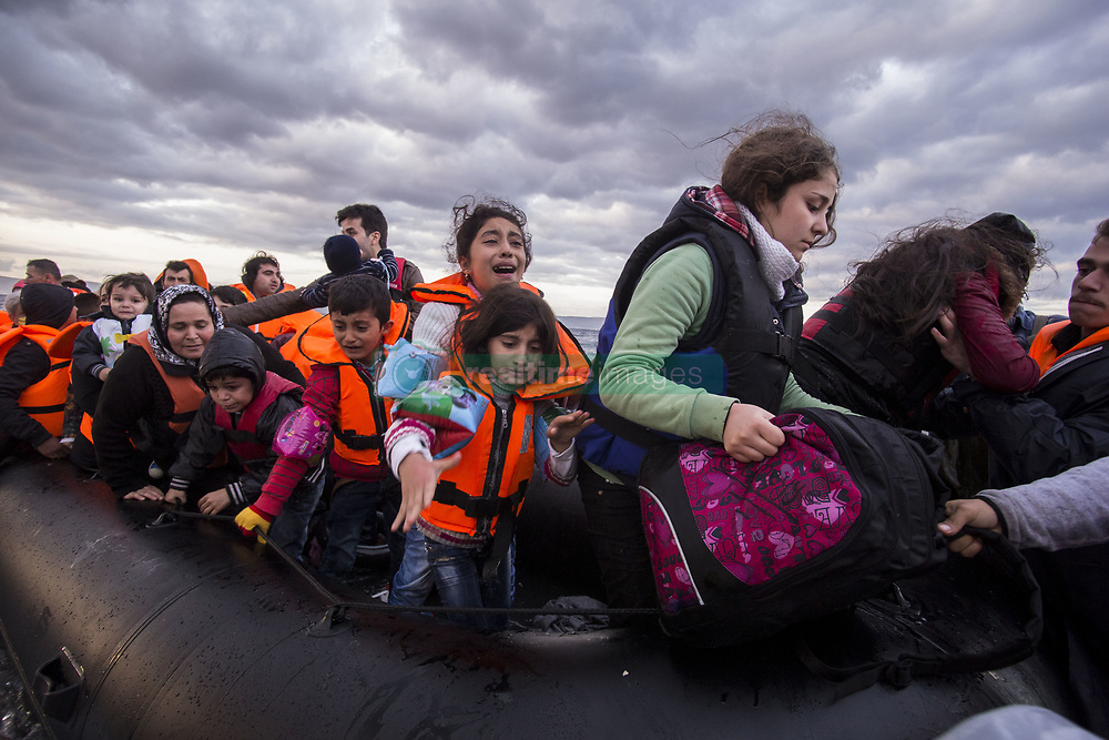 October 29, 2015 - Lesbos, Greece - Syrian and many Afghan migrants / refugees arrive from Turkey on boat through sea with cold water near Molyvos, Lesbos on overloaded dinghies. Leaving Syria or Afghanistan or Iraq because of the war. They are all trying to reach northern Europe like Germany or Sweden. In October of 2015 the average arrival of refugees in Greece was about 5500 people per day. There were days with 7000 people on low quality boats. Also many people died as their boat / dinghy sunk or run out of fuel and they were exhausted on overloaded boats. Locals and volunteers from all over the world reached the area and tried to help supporting the weak for the situation Greek coast guard. Lesvos island, Greece - 29 and 30 October 2015. (Credit Image: © Nicolas Economou/NurPhoto via ZUMA Press)