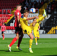 Oxford United's Josh Ruffels under pressure from Lincoln City's James Jones<br /> <br /> Photographer Chris Vaughan/CameraSport<br /> <br /> The EFL Sky Bet League One - Saturday 12th September 2020 - Lincoln City v Oxford United - LNER Stadium - Lincoln<br /> <br /> World Copyright © 2020 CameraSport. All rights reserved. 43 Linden Ave. Countesthorpe. Leicester. England. LE8 5PG - Tel: +44 (0) 116 277 4147 - admin@camerasport.com - www.camerasport.com - Lincoln City v Oxford United