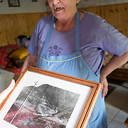 LONGARONE, ITALY - SEPTEMBER 26:  Elvira one of the oldest survivors in Casso shows an old picture before the damn had been built on  September 26, 2013 in Longarone, Italy. The Vajont  tragedy happened on the night of the 9th October 1963, when a landslide broke away from Mount Toc and fell into the Vajont river causing a wave that struck the neighboring towns, the devastation was total, more than 2000 people died and only few lucky villagers survived.  (Photo by Marco Secchi/Getty Images)