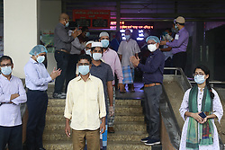Doctors and other medical staff clap as the Covid-19 recovered patients leave the hospital in Dhaka, Bangladesh, May 2, 2020. Photo by Suvra Kanti Das/ABACAPRESS.COM