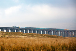 © Licensed to London News Pictures. 14/02/2017. Ribblehead UK. Picture shows the Peppercorn A1 steam locomotive, Tornado crossing the Ribblehead viaduct in the Yorkshire Dales, the first time in 50 years a scheduled mainline service has run on the Appleby to Skipton route. Photo credit: Andrew McCaren/LNP