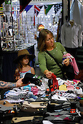 Mother and daughter (6 years old) shopping at Paddy's Market. Sydney, Australia