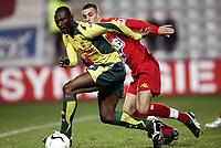 Fotball<br /> Frankrike<br /> Foto: Dppi/Digitalsport<br /> NORWAY ONLY<br /> <br /> FOOTBALL - FRENCH CHAMPIONSHIP 2006/2007 - LEAGUE 1 - FC NANTES v LE MANS UC - 09/12/2006 - MAMADOU DIALLO (NAN) / CYRIAQUE LOUVION (MANS)