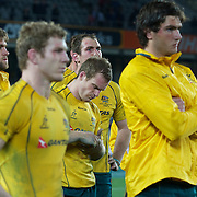 Dejected Wallaby players at the end of game presentations after thier loss during the New Zealand V Australia Tri-Nations, Bledisloe Cup match at Eden Park, Auckland. New Zealand. 6th August 2011. Photo Tim Clayton