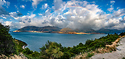 Rainbow, blue sky, and clouds over Lake Hawea. Southern Alps, Otago region, South Island of New Zealand. This image was stitched from multiple overlapping photos.