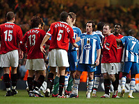 Photo: Ed Godden.<br />Manchester United v Wigan Athletic. The Carling Cup Final. 26/02/2006. Rio Ferdinand shakes the hand of Wigans Leighton Barnes at the end of the game.