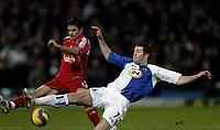 Photo: Jonathan Butler.<br />Blackburn Rovers v Liverpool. The Barclays Premiership. 26/12/2006.<br />Brett Emerton of Blackburn stretches for the ball with Mark Gonzalez of Liverpool.