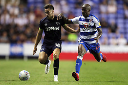 Derby County's Tom Lawrence (left) and Reading's Sone Aluko battle for the ball during the Sky Bet Championship match at the Madejski Stadium, Reading.