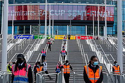 © Licensed to London News Pictures. 18/04/2021. LONDON, UK. Security guards on the new steps outside Wembley Stadium ahead of the FA Cup semi-final match between Leicester City and Southampton.   4,000 local residents have been invited to attend the match, the largest number of spectators attending a match in a UK stadium for over a year.  Covid-19 testing will take before and after the match and data gathered will be used to plan how all sports tournaments can escape lockdown.  Photo credit: Stephen Chung/LNP