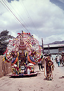 Captioned 'A lone Indian' elaborate decoration for one person at carnival, Trinidad 1962