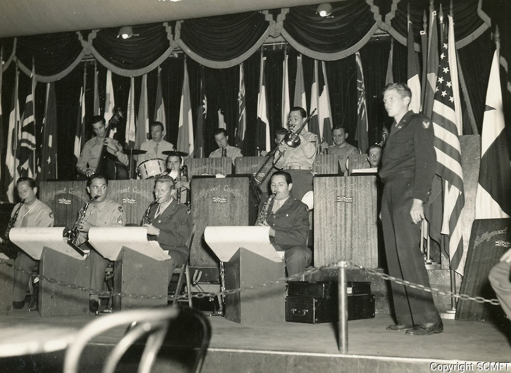 11/22/45 The 684th Army Air Force Band entertains the Hollywood Canteen's audience on the Canteen's last night. W/O Alexandra Courage (at right) is the bandleader.
