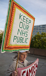 © Licensed to London News Pictures. 07/09/2011. London, UK. Save the NHS Demonstration coincided with the third reading of the Government's Health and Social Care Bill. Demonstrators marched across Westminster Bridge to the Houses of Parliament where they held a candle-lit vigil. The demonstration was supported by Unite the Union, Keep our NHS Private, the Health Worker Network, Right to Work, Unison and the Tradeunion Congress. Photo credit: Bettina Strenske/LNP