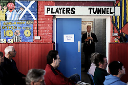 """© London News Pictures. """"Looking for Nigel"""". A body of work by photographer Mary Turner, studying UKIP leader Nigel Farage and his followers throughout the 2015 election campaign. PICTURE SHOWS - Nigel Farage waits in the hallway of the St Luke's Community Centre in Ramsgate, before going out to speak at a public meeting in the venue in Kent, on April 18th 2015. The local centre was typical of the small and traditional venues that UKIP chose throughout his campaign to appeal to his audience's sense of 'Britishness'. . Photo credit: Mary Turner/LNP **PLEASE CALL TO ARRANGE FEE** **More images available on request**"""