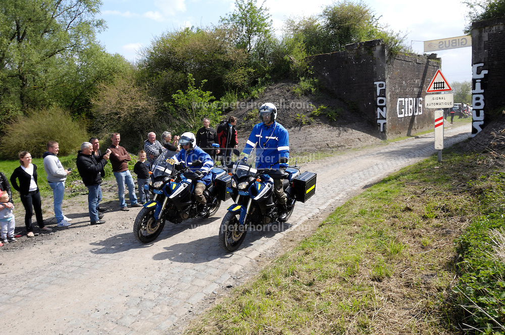 France, April 13th 2014: Gendarme motorcyclists marshall the 2014 Paris Roubaix cycle action at Pont Gibus, Wallers.