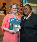 Challenge High School social worker Rachel Reedy, left, is recognized as Houston ISD Employee of the Month by principal Tonya Miller, right, during a Board of Education meeting, April 10, 2014.