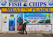 Fish and Chip shop closed for repair on 21st April 2021 in Blackpool, Lancashire, United Kingdom. Blackpool is a large town and seaside resort in the county of Lancashire on the north west coast of England. Blackpool was once a booming resort with it's famous promenade which now, despite having a somewhat shabby appearance, still continues to attract millions of visitors each year. During the coronavirus pandemic however, Blackpool has struggled, with empty streets and closed down businesses creating an atmosphere more like a ghost town.