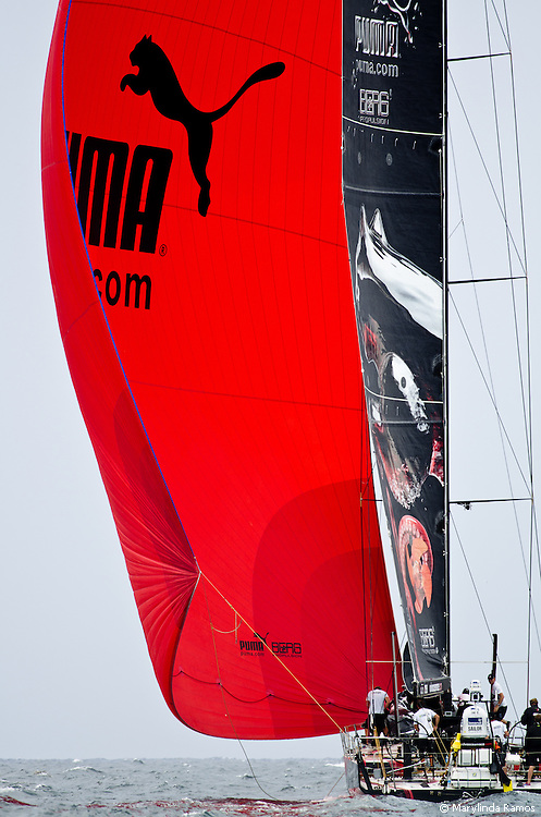 Puma leaving the upwind mark under spinnaker at the in-port race during the 2011-2012 Volvo Ocean Race Miami stopover.