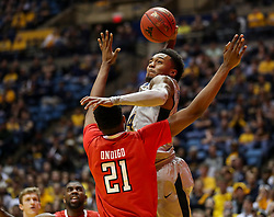 Feb 26, 2018; Morgantown, WV, USA; West Virginia Mountaineers guard Daxter Miles Jr. (4) attempts to dunk over Texas Tech Red Raiders forward Malik Ondigo (21) during the second half at WVU Coliseum. Mandatory Credit: Ben Queen-USA TODAY Sports