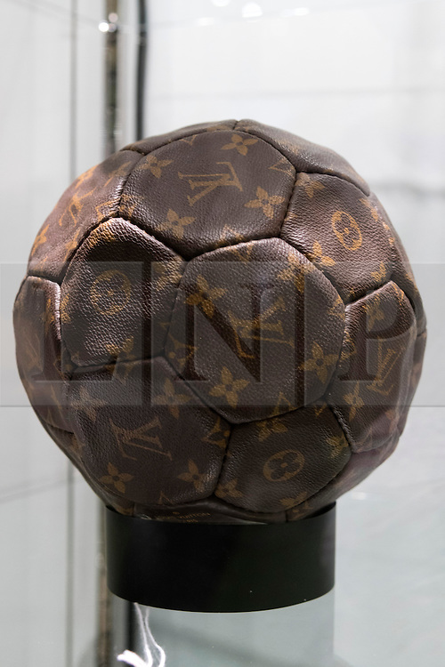 © Licensed to London News Pictures. 01/06/2016. A Louis Vuitton limited edition canvas football presented to Pepe to commemorate the 1998 World Cup in France with an estimate of £700-£1,400 from the Pele: The Collection with over 1,500 items of memorabilia owned by Pele for sale on later in June. London, UK. Photo credit: Ray Tang/LNP
