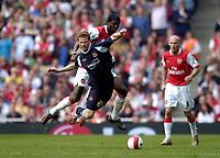 Photo: Olly Greenwood.<br />Arsenal v West Ham United. The Barclays Premiership. 07/04/2007. West Ham's George McCartney is fouled by Arsenal's Emmanuel Adebayor