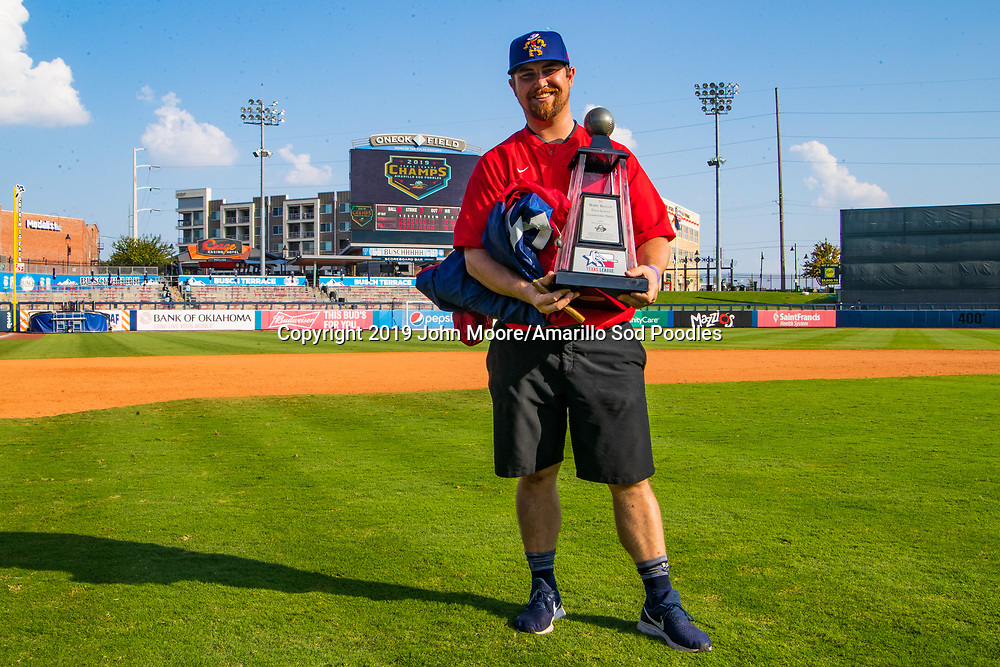 Jacob Dwiggins poses with the trophy after the Sod Poodles won against the Tulsa Drillers during the Texas League Championship on Sunday, Sept. 15, 2019, at OneOK Field in Tulsa, Oklahoma. [Photo by John Moore/Amarillo Sod Poodles]