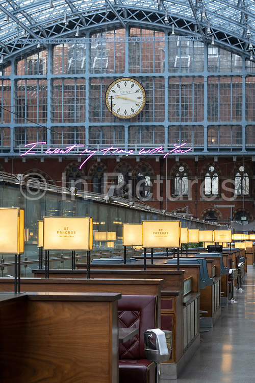 St Pancras International Train Station on the 9th October 2019 in London in the United Kingdom. The station is the site of Tracey Emin's new installation, a single-sentence text: 'I want my time with you'. The 18 letters are written in 20 metres of pink neon, one of Emin's staple materials.