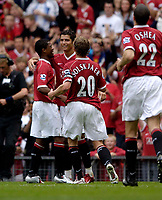Photo: Jed Wee.<br />Manchester United v Seville. Pre Season Friendly. 12/08/2006.<br /><br />A sheepish Cristiano Ronaldo (C) takes the congratulations of his Manchester United team mates after his shot deflects into the back of the net.