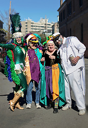 09 February 2016. New Orleans, Louisiana.<br /> Mardi Gras Day. Amy George Hirons and her parents. Revelers in bright and colourful costumes fill the French Quarter. <br /> Photo©; Charlie Varley/varleypix.com