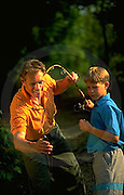 Outdoor recreation, Father and Son Catch Fish,