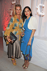 Left to right, EMMA WOOLLARD and YASMIN MILLS at a party hosted by Ines de la Frassange and Bruno Frisoni for Roger Vivier to launch the Roger Vivier book held at The Saatchi Gallery, London on 24th April 2013.
