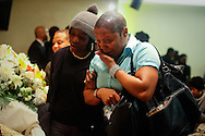 Mourners grieve at a homegoing for Joy Chatel, known as Mama Joy,a well known community activist, dancer, and cosemetologist, at the Frank R. Bell Funeral Home in Brooklyn.