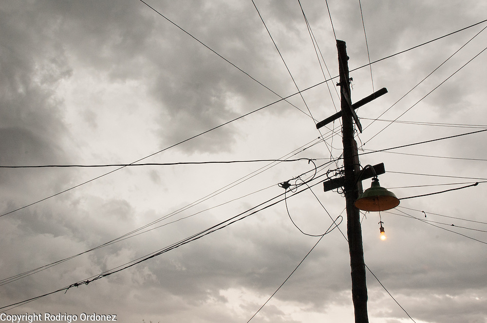 Ocho de Mayo is crisscrossed overhead with electric wires tapping power from the few existing streetlights. The neighborhood lacks a reliable supply of electricity.