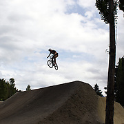 Riders in action during the Gorge Road Mega Jam, for BMX and Mountain Bike riders to mark the opening  of the Gorge Road Jump Park run by the Queenstown Mountain Bike Club,  Queenstown, New Zealand. 3rd December 2011. Photo Tim Clayton