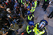 June 3, 2020, London, England, United Kingdom: Police clash with protesters in central London on Wednesday, June 3, 2020, after a demonstration over the death of George Floyd, a black man who died after being restrained by Minneapolis police officers on May 25. Protests have taken place across America and internationally after a white Minneapolis police officer pressed his knee against Floyd's neck while the handcuffed black man called out that he couldn't breathe. The officer, Derek Chauvin, has been fired and charged with murder. (Credit Image: © Vedat Xhymshiti/ZUMA Wire)