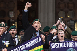 Royal Courts of Justice, London, February 8th 2017. As day two for the appeal hearing for 'Marine A' - Sgt Alex Blackman draws to a close, retired Marines and supporters gather on the steps of the High Court as his wife Claire emerges from the building. PICTURED: A man in a Marines beret leads 'Three Cheers for Sergeant Blackman'.