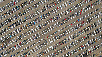 Aerial view of colourful cars abstractly parked ready to sell in Malaga Port, Spain