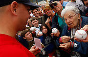 """Hernando, Fla. resident Norma Murphy has a Polaroid picture she took of pitcher Joe Nelson autographed on the first day of Red Sox spring training on Saturday, Feb. 20, 2010 in Fort Myers. """"I take their picture then have them autograph it before it develops,"""" said Murphy of her memorabilia collecting technique. Pitchers, catchers and coaches practiced at the event opened to the public at the Player Development Complex. David Albers/Staff"""