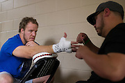 DALLAS, TX - MARCH 14:  Jared Rosholt has his hands wrapped back stage before fighting Josh Copeland during UFC 185 at the American Airlines Center on March 14, 2015 in Dallas, Texas. (Photo by Cooper Neill/Zuffa LLC/Zuffa LLC via Getty Images) *** Local Caption *** Jared Rosholt