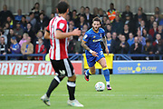 AFC Wimbledon defender Callum Kennedy (23) dribbling during the EFL Cup match between AFC Wimbledon and Brentford at the Cherry Red Records Stadium, Kingston, England on 8 August 2017. Photo by Matthew Redman.