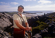 A portrait of Lord Strathcona on rocks of the Scottish island his family has owned for generations, in the summer of 1989 on Colonsay, Scotland. Donald Euan Palmer Howard, 4th Baron Strathcona and Mount Royal (b1923), is a British Conservative politician. Strathcona is the eldest son of Donald Howard, 3rd Baron. He served in the Royal Navy from 1942 to 1947, achieving the rank of Lieutenant. Howard succeeded his father in the barony in 1959 and took his seat on the Conservative benches in the House of Lords.