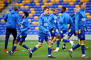 AFC Wimbledon defender Jack Currie (26) warming up prior to kick off during the EFL Sky Bet League 1 match between AFC Wimbledon and Lincoln City at Plough Lane, London, United Kingdom on 2 January 2021.