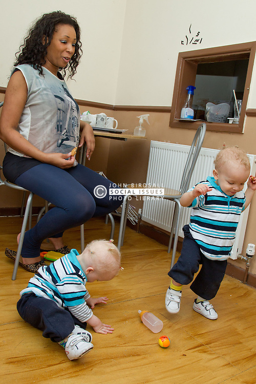 Small twin boys with mother. (This photo has extra clearance covering Homelessness, Mental Health Issues, Bullying, Education and Exclusion, as well as the usual clearance for Fostering & Adoption and general Social Services contexts,)