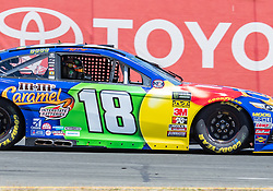 June 22, 2018 - Sonoma, CA, U.S. - SONOMA, CA - JUNE 22:  Kyle Busch, driving the (18) Toyota for Joe Gibbs Racing accelerates out of turn 8a on Friday, June 22, 2018 at the Toyota/Save Mart 350 Practice day at Sonoma Raceway, Sonoma, CA (Photo by Douglas Stringer/Icon Sportswire) (Credit Image: © Douglas Stringer/Icon SMI via ZUMA Press)
