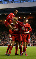 Photo. Jed Wee.<br /> Liverpool v Bolton Wanderers, FA Barclaycard Premiership, Anfield, Liverpool. 26/12/2003.<br /> Liverpool goalscorer Sami Hyypia (C) is mobbed by Steven Gerrard (R) and Florent Sinama-Pongolle.