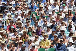© Licensed to London News Pictures. 02/07/2018. London, UK. Spectators watch centre court tennis in the sweltering heat at the Wimbledon Tennis Championships 2018 <br /> . Photo credit: Ray Tang/LNP