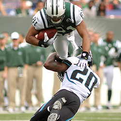 Nov 15, 2009; East Rutherford, NJ, USA; Jacksonville Jaguars safety Anthony Smith (20) upends New York Jets tight end Dustin Keller (81) after a Keller made a reception during first half NFL action between the New York Jets and Jacksonville Jaguars at Giants Stadium.