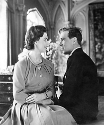 Princess Margaret and her fiancé, photographer Antony Armstrong-Jones, pictured at the Royal Lodge, Windsor, where the newly-engaged couple spent the weekend.