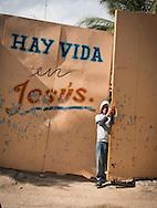 Boy at revivalist church entrance, Havana, Cuba
