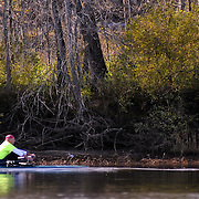 11/12/11 -- BRUNSWICK, Maine.  Dave Hillman of Brunswick rows on the Androscoggin River on Saturday morning. Unseasonal high temperatures have hit the Midcoast this week, scaring off the Halloween snow. Photo by Roger S. Duncan.