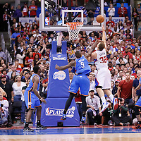 11 May 2014: Los Angeles Clippers forward Blake Griffin (32) goes for the layup against Oklahoma City Thunder forward Serge Ibaka (9) during the Los Angeles Clippers 101-99 victory over the Oklahoma City Thunder, during Game Four of the Western Conference Semifinals of the NBA Playoffs, at the Staples Center, Los Angeles, California, USA.